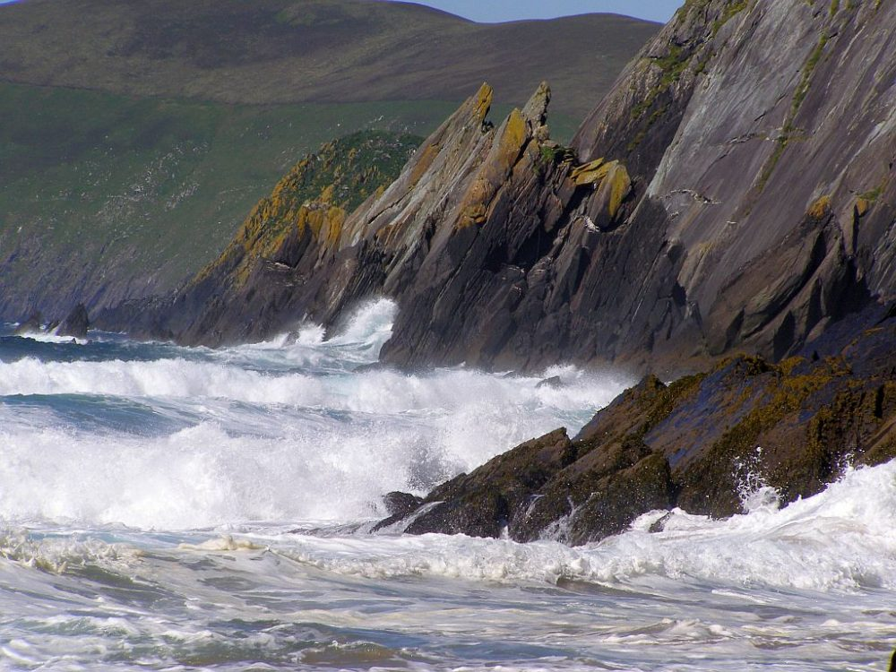 The Atlantic Ocean at Sleahead in Ireland forcibly forming the coast.